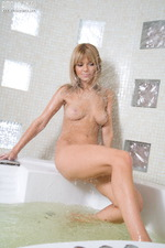 Blonde Teen Plays With Her Wet Pussy In The Bath 10