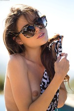 Seductive Brunette Valeria Stripping Naked Poolside 06