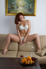 Busty Redhead Babe Feya Strips 03