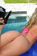 Melissa's triangle thong bikini on a raft 10