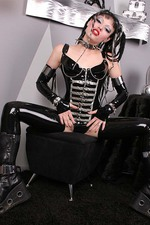 Gothic Girl in Latex with a Big Spiked Dildo 01