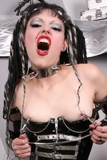Gothic Girl in Latex with a Big Spiked Dildo 06
