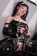 Gothic Girl in Latex with a Big Spiked Dildo 07