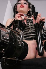 Gothic Girl in Latex with a Big Spiked Dildo 08