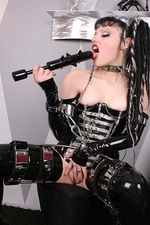 Gothic Girl in Latex with a Big Spiked Dildo 09