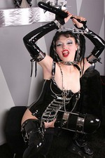 Gothic Girl in Latex with a Big Spiked Dildo 10