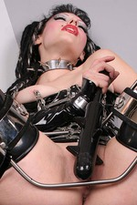 Gothic Girl in Latex with a Big Spiked Dildo 11