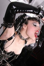 Gothic Girl in Latex with a Big Spiked Dildo 12
