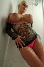 Busty Mary poses in a steamy shower 06