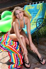 Blue peekaboo string bikini & oil 04