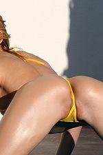 Blonde nympho in sheer micro bikini  05