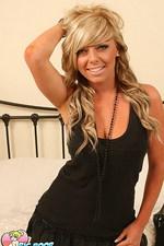 Sweet blond teen undresses 00