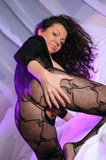 Curly petite brunette in a lace body 08