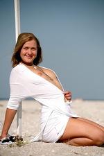 Gorgeous Margo posing on football field 03