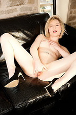 Martha on a leather sofa 11