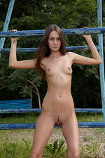 Angelina playing on steel bars!  02