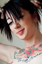 Tattooed Goth girl shows off her corset 13
