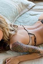 Emma tattoed beauty in sexy stockings 12