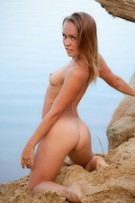 Valeri poses nude by the sea 00