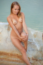 Valeri poses nude by the sea 05