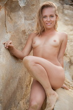 Valeri poses nude by the sea 11