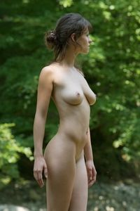 Lovely babe refreshing nude in the river