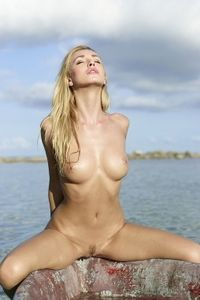 Naked Blonde Babe Posnig On A Boat