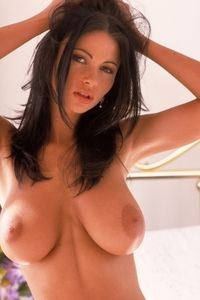 Veronica spreads her nude body on a bed