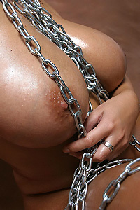 Kora Kryk Oiled Up And Chained