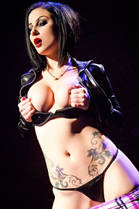 Tattoed Leather Chick In Leather