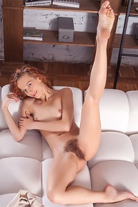 sexy French redhead readily reveals her tiny breasts