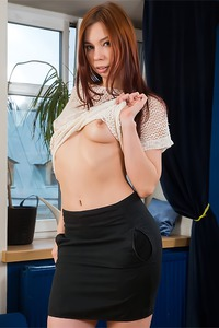 Sexy schoolgirl Adell Simons getting nude